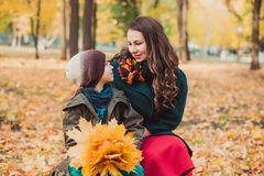 Mom and son walk in the autumn Park. Happy family. Autumn concept. royalty free stock image