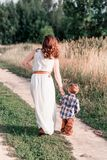 Mom and son on a walk in the field stock photo