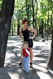 Mom and son on a walk in park Stock Photos