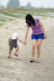 Mom and Son Walking on Beach Royalty Free Stock Photo