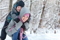 Mom and son in the winter. Beautiful young mother walking with her son in the winter forest Royalty Free Stock Images