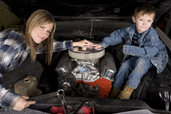 Mom and son working on car Royalty Free Stock Photography