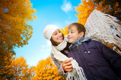 Mom with son in a yellow autumn park Royalty Free Stock Image