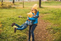 Mom and son in yellow hats walking in the woods royalty free stock photos