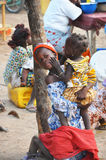 Mom and song in an African market. A mother and her song with colorful dress in a African market Stock Photography