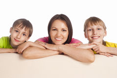 Mom with sons at sofa. Portrait of a cute mom with her sons Royalty Free Stock Images