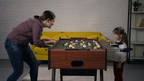 Mom and special needs child enjoying table soccer stock video footage