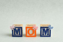 Mom spelled with alphabet blocks Stock Photography