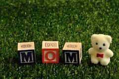 Mom spelled with colorful alphabet blocks Royalty Free Stock Image