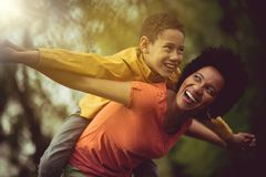 With mom support I can achieve anything. ! Mother and son in the park royalty free stock photo