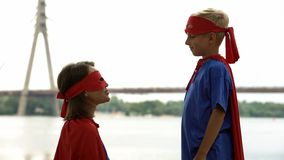 Mom supports son in superhero game, psychotherapy for boy to cope with problems royalty free stock photos