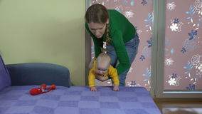 Mom swipe baby finger over rough surfaces. Fine motor training stock video footage