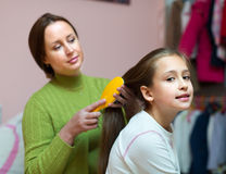 Mom taking care of daughter hair Royalty Free Stock Images