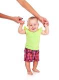 Mom teaches baby to walk Stock Image