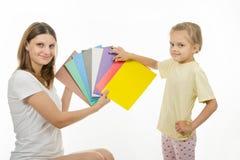 Mom teaches a child the correct color perception Stock Photos