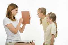 Mom teaches children to distinguish colors Stock Images