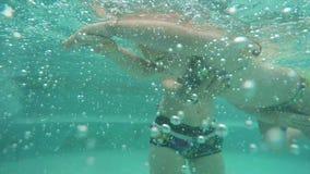 Mom teaches daughter swim stock video