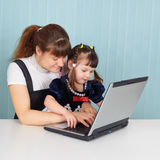 Mom teaches daughter to use computer Royalty Free Stock Photo