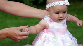 Mom teaches her baby to walk stock video footage