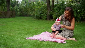 Mom teaches her baby to walk stock footage