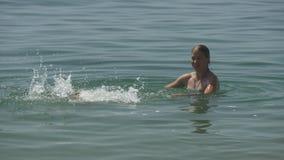 Mom teaches son to swim stock video