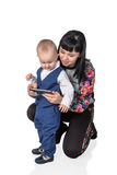 Mom teaches son to use a smartphone Royalty Free Stock Image