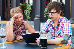 Mom teaches son to use tablet Royalty Free Stock Photo