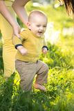 Mom teaches son walking grass Stock Images