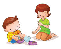 Mom teaches son wear shoes. Mom teaches cute son wearing shoes Stock Images