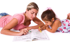 Mom teaching daughter. Stock Photo