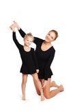 Mom teaching daughter gymnastics Royalty Free Stock Photos