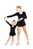 Mom teaching daughter gymnastics Stock Photo