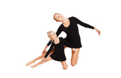 Mom teaching daughter gymnastics Royalty Free Stock Photography