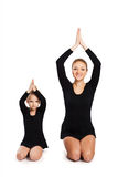 Mom teaching daughter gymnastics Royalty Free Stock Image