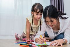 Mom teaching her daughter to drawing in art class. Back to school and Education concept. Children and kids theme. Home sweet home. Theme stock images