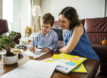 Mom Teaching Her Son Doing Homework royalty free stock photos
