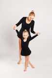 Mom teaching kid dancing. mother and daughter Royalty Free Stock Photo