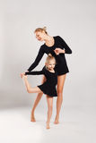 Mom teaching kid dancing. mother and daughter Stock Image