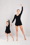 Mom teaching kid dancing. mother and daughter Stock Photos