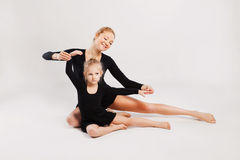 Mom teaching kid dancing. mother and daughter Royalty Free Stock Image