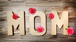 MOM text in big cardboard letters with flowers Stock Images