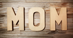 MOM text in big cardboard letters Royalty Free Stock Photo