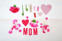 Mom text with clothespins and carnations Royalty Free Stock Photo