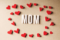 MOM text with small red hearts Royalty Free Stock Image