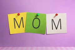 Mom text written on colorful paper note Stock Images