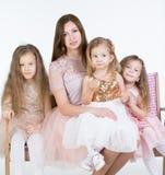 Mom with three kids Girls Stock Photos