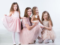 Mom with three kids Girls Stock Images