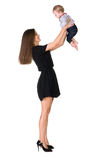 Mom throws baby daughter in air Stock Image