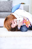 Mom tickles her child Royalty Free Stock Image
