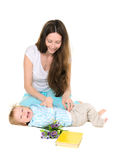 Mom tickles his little son Stock Images
